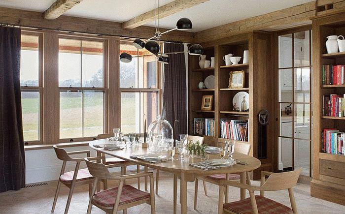 Книги как элемент декора столовой от David Nelson & Associates
