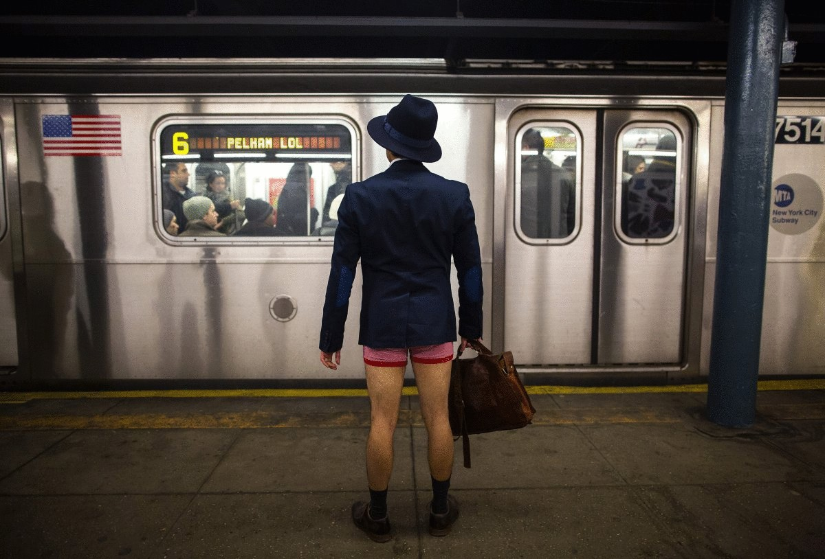 a-man-takes-part-in-the-annual-no-pants-subway-ride-in-new-york-on-jan-12-2014
