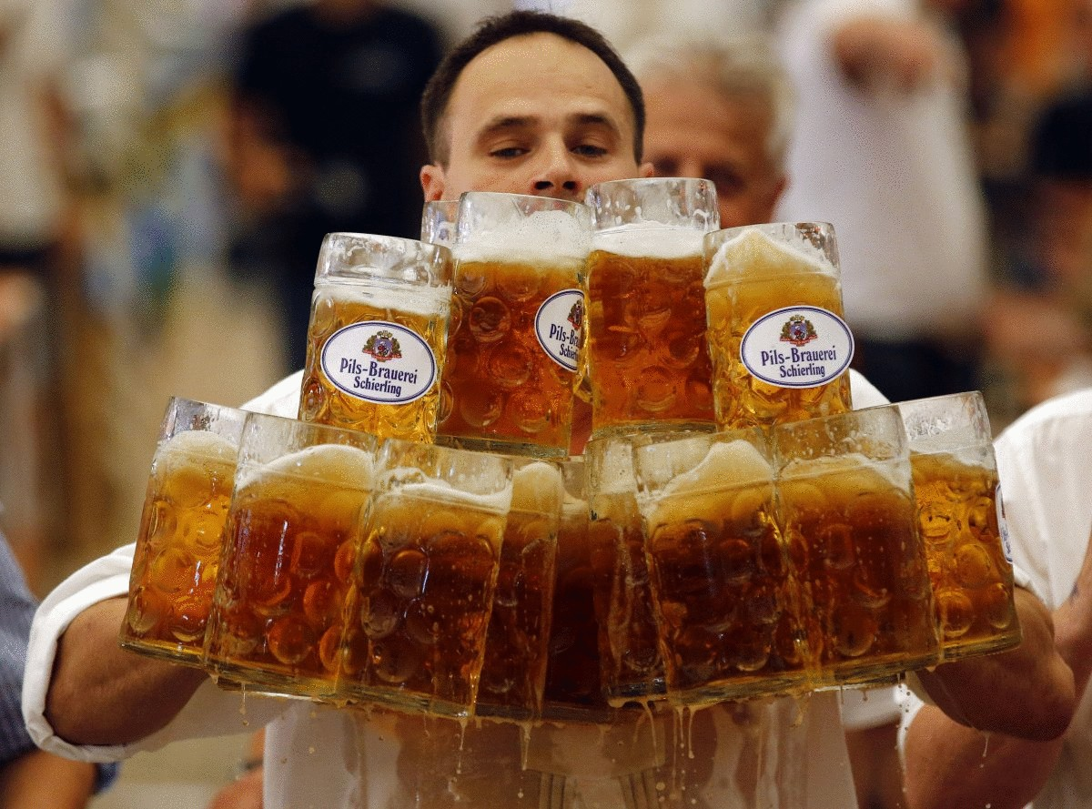 german-oliver-stuempfl-competes-to-set-a-new-world-record-for-carrying-one-liter-beer-mugs-over-a-distance-of-131-feet-on-sept-7-struempfl-carried-27-mugs-to-set-a-new-world-record