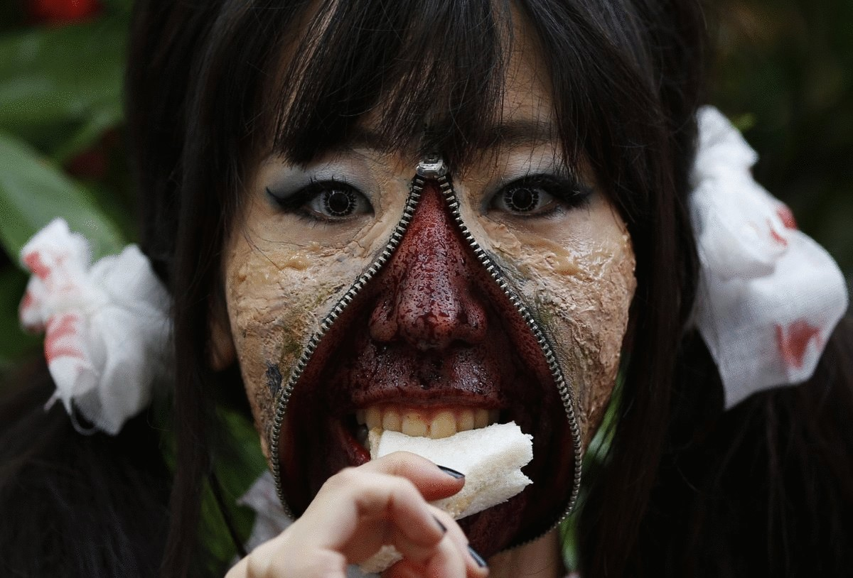 a-participant-in-costume-eats-a-sandwich-after-a-halloween-parade-in-kawasaki-south-of-tokyo-on-oct-26-more-than-100000-spectators-turned-up-to-watch-the-parade-where-2500-participants-dressed-up-in-costumes